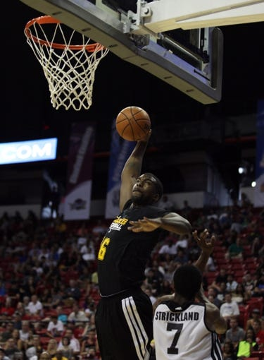 Jul 14, 2013; Las Vegas, NV, USA; Los Angeles Lakers center Travis Hyman eyes the basket before scoring on a dunk over Portland Trailblazers guard Dexter Strickland during an NBA Summer League game at the Thomas and Mack Center. Mandatory Credit: Stephen R. Sylvanie-USA TODAY Sports