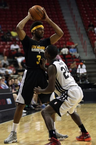 Jul 14, 2013; Las Vegas, NV, USA; Los Angeles Lakers forward Lazar Hawyard looks for a play to develop while being defended by Portland Trailblazers guard Terrel Harris during an NBA Summer League game at the Thomas and Mack Center . Mandatory Credit: Stephen R. Sylvanie-USA TODAY Sports