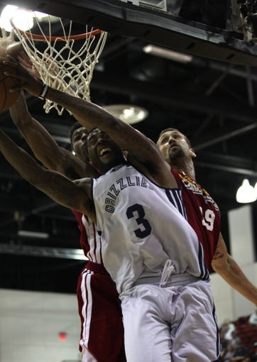 Jul 14, 2013; Las Vegas, NV, USA; Memphis Grizzlies center Willie Reed struggles to maintain control of the ball from Cleveland Cavaliers center Josh Heytvelt and guard Carrick Felix during the second half of an NBA Summer League game at Cox Pavillion. Cleveland won the game 69-58. Mandatory Credit: Stephen R. Sylvanie-USA TODAY Sports