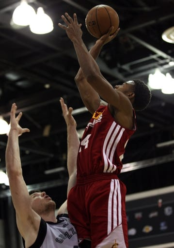 Jul 14, 2013; Las Vegas, NV, USA; Cleveland Cavaliers guard Corey Higgins leaps above Memphis Grizzlies center Jack Cooley during an NBA Summer League game at Cox Pavillion. Cleveland won the game 69-58. Mandatory Credit: Stephen R. Sylvanie-USA TODAY Sports