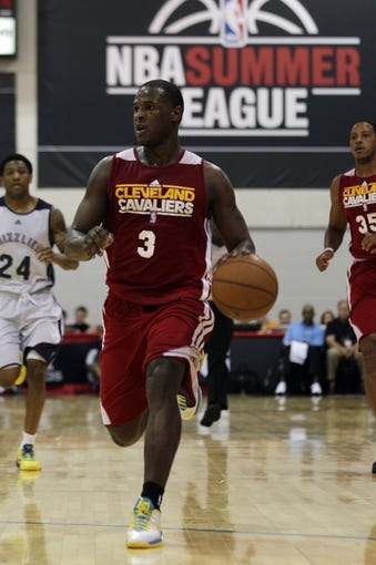 Jul 14, 2013; Las Vegas, NV, USA; Cleveland Cavaliers guard Dion Waiters dribbles the ball into the zone during an NBA Summer League game against the Memphis Grizzlies at Cox Pavillion. Cleveland won the game 69-58. Mandatory Credit: Stephen R. Sylvanie-USA TODAY Sports