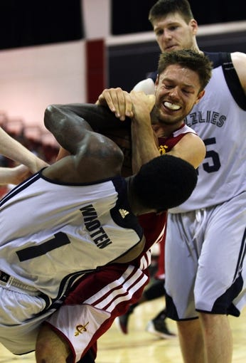 Jul 14, 2013; Las Vegas, NV, USA; Cleveland Cavaliers guard Matthew Dellavedova and Memphis Grizzies guard Tony Wroten battle for control of the ball, resulting in a jump ball, during an NBA Summer League game at Cox Pavillion. Also pictured in the play is Memphis Grizzlies center Jack Cooley. Cleveland won the game 69-58. Mandatory Credit: Stephen R. Sylvanie-USA TODAY Sports