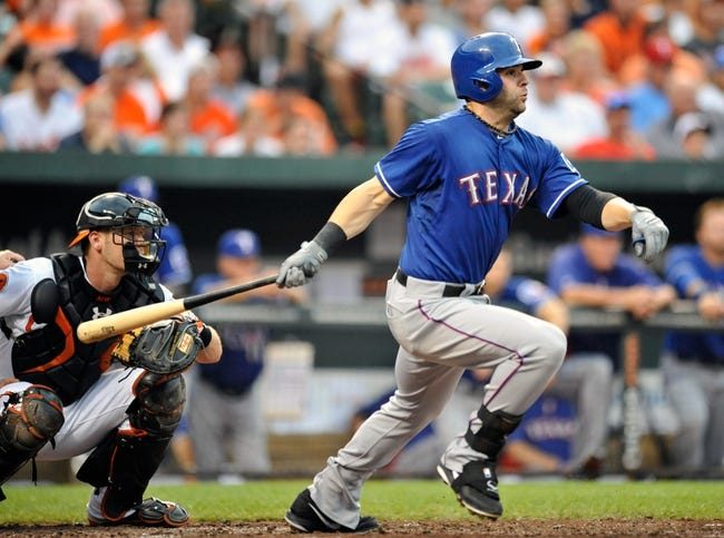 Jul 10, 2013; Baltimore, MD, USA; Texas Rangers first baseman Mitch Moreland (18) bats in the second inning against the Baltimore Orioles at Oriole Park at Camden Yards. The Orioles defeated the Rangers 6-1. Mandatory Credit: Joy R. Absalon-USA TODAY Sports