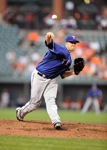 Jul 10, 2013; Baltimore, MD, USA; Texas Rangers starting pitcher Josh Lindblom (25) throws in the third inning against the Baltimore Orioles at Oriole Park at Camden Yards. The Orioles defeated the Rangers 6-1. Mandatory Credit: Joy R. Absalon-USA TODAY Sports
