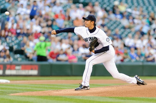Jul 9, 2013; Seattle, WA, USA; Seattle Mariners starting pitcher Hisashi Iwakuma (18) pitches to the Boston Red Sox during the game at Safeco Field. Boston defeated Seattle 11-8. Mandatory Credit: Steven Bisig-USA TODAY Sports
