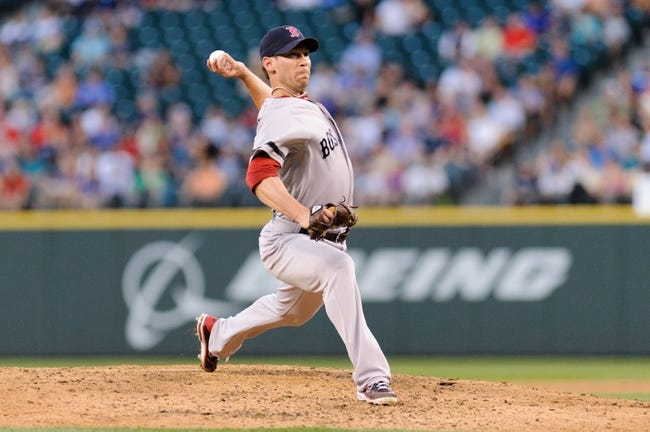 Jul 9, 2013; Seattle, WA, USA; Boston Red Sox relief pitcher Craig Breslow (32) pitches to the Seattle Mariners during the game at Safeco Field. Boston defeated Seattle 11-8. Mandatory Credit: Steven Bisig-USA TODAY Sports