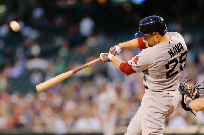 Jul 9, 2013; Seattle, WA, USA; Boston Red Sox left fielder Daniel Nava (29) hits the ball against the Seattle Mariners during the game at Safeco Field. Boston defeated Seattle 11-8. Mandatory Credit: Steven Bisig-USA TODAY Sports