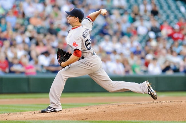 Jul 9, 2013; Seattle, WA, USA; Boston Red Sox starting pitcher Allen Webster (64) pitches to the Seattle Mariners during the game at Safeco Field. Boston defeated Seattle 11-8. Mandatory Credit: Steven Bisig-USA TODAY Sports