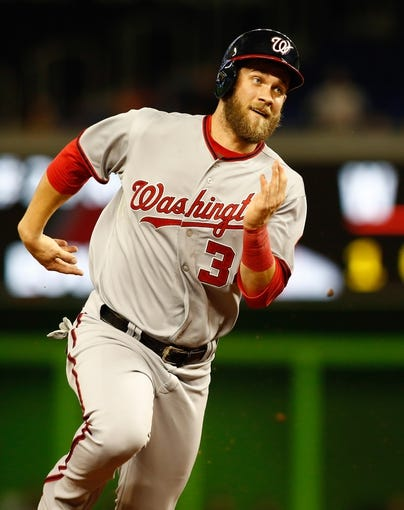 Jul 12, 2013; Miami, FL, USA; Washington Nationals left fielder Bryce Harper (34) runs to third base in the first inning against the Miami Marlins at Marlins Park.  Mandatory Credit: Robert Mayer-USA TODAY Sports