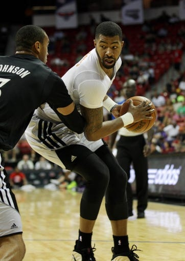 Jul 15, 2013; Las Vegas, NV, USA; Phoenix Suns center Markieff Morris (right) protects the ball from Minnesota Timberwolves forward Chris Johnson during an NBA Summer League game at the Thomas and Mack Center. Mandatory Credit: Stephen R. Sylvanie-USA TODAY Sports