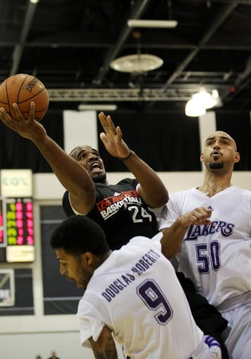 Jul 15, 2013; Las Vegas, NV, USA; Los Angeles Clippers power forward Samard Samuels (24) is fouled by Los Angeles Lakers guard Chris Douglas-Roberts (9) during an NBA Summer League game at the Cox Pavillion. Also pictured in the play is Lakers forward Robert Sacre. Mandatory Credit: Stephen R. Sylvanie-USA TODAY Sports