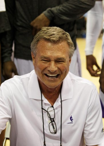 Jul 15, 2013; Las Vegas, NV, USA; Los Angeles Lakers coach Dan D'Antoni laughs with a player during a timeout from an NBA Summer League game against the Los Angeles Clippers at the Cox Pavillion. Mandatory Credit: Stephen R. Sylvanie-USA TODAY Sports