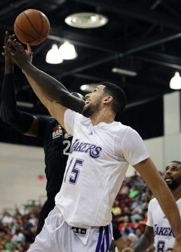 Jul 15, 2013; Las Vegas, NV, USA; Los Angeles Lakers forward Mitchell Watt (15) battles Los Angeles Clippers center Vernon Macklin for control of a rebound during an NBA Summer League game at Cox Pavillion. Also pictured in the play is Lakers guard D.J. Seeley. Mandatory Credit: Stephen R. Sylvanie-USA TODAY Sports