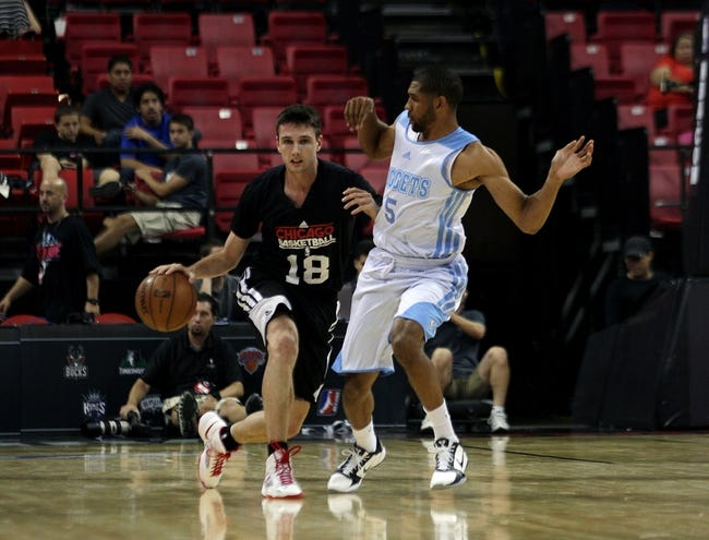 Jul 15, 2013; Las Vegas, NV, USA; Chicago Bulls guard Matt Janning (18) dribbles the ball around Denver Nuggets guard C.J. Harris during an NBA Summer League game at the Thomas and Mack Center. Mandatory Credit: Stephen R. Sylvanie-USA TODAY Sports