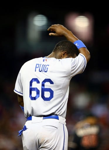 Jul. 8, 2013; Phoenix, AZ, USA: Los Angeles Dodgers outfielder Yasiel Puig reacts against the Arizona Diamondbacks at Chase Field. Mandatory Credit: Mark J. Rebilas-USA TODAY Sports