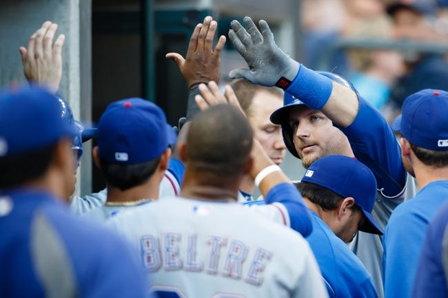 July 12, 2013; Detroit, MI, USA; Texas Rangers catcher A.J. Pierzynski (12) receives congratulations from teammates after he hits a home run against the Detroit Tigers at Comerica Park. Mandatory Credit: Rick Osentoski-USA TODAY Sports
