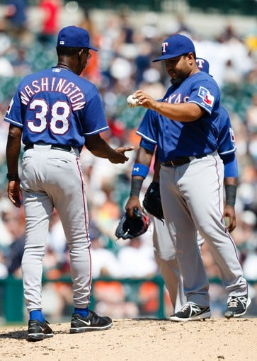 July 14, 2013; Detroit, MI, USA; Texas Rangers manager Ron Washington (38) takes the ball to relieve relief pitcher Joe Ortiz (58)  in the eighth inning against the Detroit Tigers at Comerica Park. Detroit won 5-0. Mandatory Credit: Rick Osentoski-USA TODAY Sports