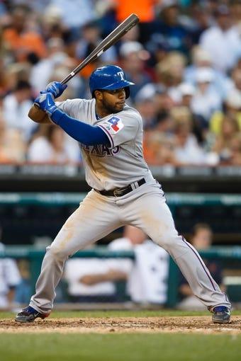 July 12, 2013; Detroit, MI, USA; Texas Rangers shortstop Elvis Andrus (1) at bat against the Detroit Tigers at Comerica Park. Mandatory Credit: Rick Osentoski-USA TODAY Sports