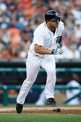 July 12, 2013; Detroit, MI, USA; Detroit Tigers shortstop Jhonny Peralta (27) runs towards first against the Texas Rangers at Comerica Park. Mandatory Credit: Rick Osentoski-USA TODAY Sports