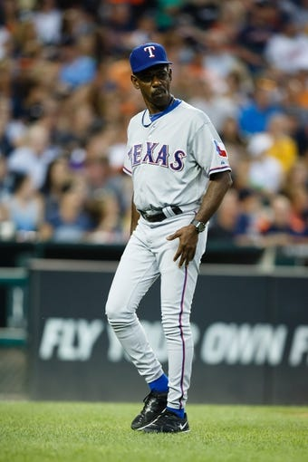 July 12, 2013; Detroit, MI, USA; Texas Rangers manager Ron Washington (38) walks off the field against the Detroit Tigers at Comerica Park. Mandatory Credit: Rick Osentoski-USA TODAY Sports
