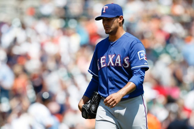 July 14, 2013; Detroit, MI, USA; Texas Rangers starting pitcher Martin Perez (33) walks off the field after being relieved in the sixth inning against the Detroit Tigers at Comerica Park. Mandatory Credit: Rick Osentoski-USA TODAY Sports