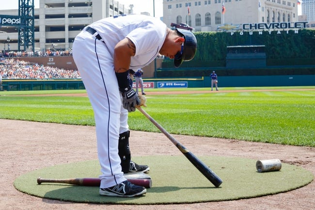 July 14, 2013; Detroit, MI, USA; Detroit Tigers third baseman Miguel Cabrera (24) gets set to bat against the Texas Rangers at Comerica Park. Mandatory Credit: Rick Osentoski-USA TODAY Sports