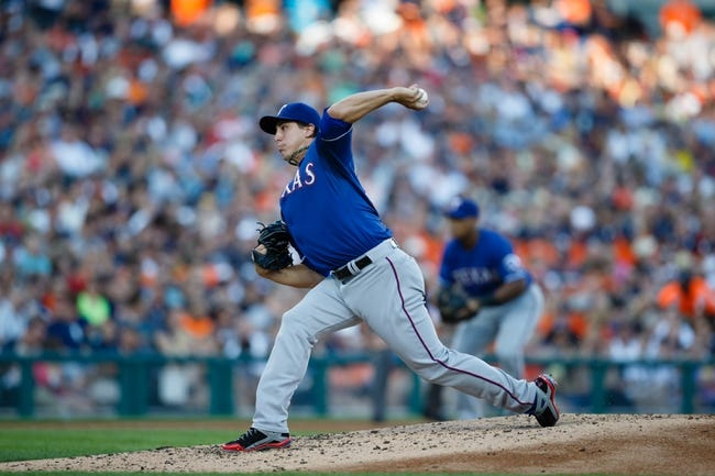 July 13, 2013; Detroit, MI, USA; Texas Rangers starting pitcher Derek Holland (45) pitches in the third inning against the Detroit Tigers at Comerica Park. Mandatory Credit: Rick Osentoski-USA TODAY Sports