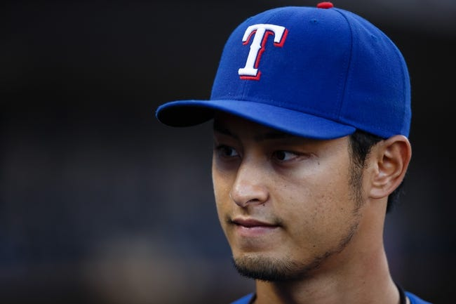 July 13, 2013; Detroit, MI, USA; Texas Rangers starting pitcher Yu Darvish (11) in the dugout during the fourth inning against the Detroit Tigers at Comerica Park. Mandatory Credit: Rick Osentoski-USA TODAY Sports