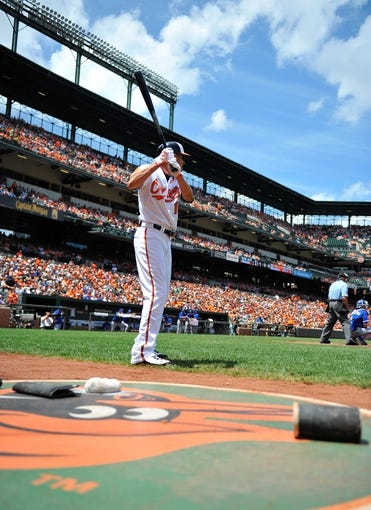 Jul 14, 2013; Baltimore, MD, USA; Baltimore Orioles third baseman Manny Machado (13) in the on-deck circle during  the first inning against the Toronto Blue Jays at Oriole Park at Camden Yards. The Orioles defeated the Blue Jays 7-4. Mandatory Credit: Joy R. Absalon-USA TODAY Sports