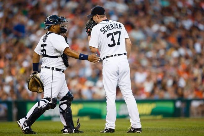 July 13, 2013; Detroit, MI, USA; Detroit Tigers catcher Brayan Pena (55) talks to starting pitcher Max Scherzer (37) against the Texas Rangers at Comerica Park. Mandatory Credit: Rick Osentoski-USA TODAY Sports