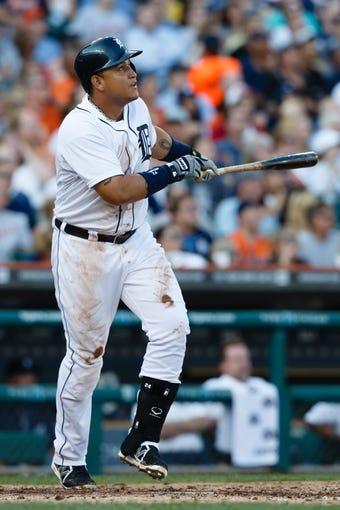 July 12, 2013; Detroit, MI, USA; Detroit Tigers third baseman Miguel Cabrera (24) at bat against the Texas Rangers at Comerica Park. Mandatory Credit: Rick Osentoski-USA TODAY Sports