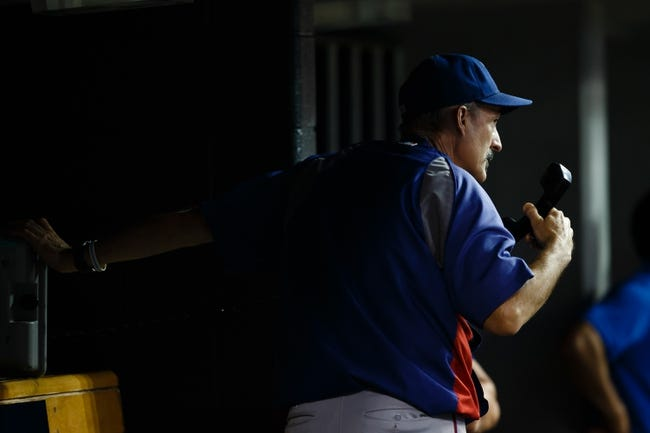 July 12, 2013; Detroit, MI, USA; Texas Rangers pitching coach Mike Maddux (31) calls the bullpen during the game against the Detroit Tigers at Comerica Park. Mandatory Credit: Rick Osentoski-USA TODAY Sports