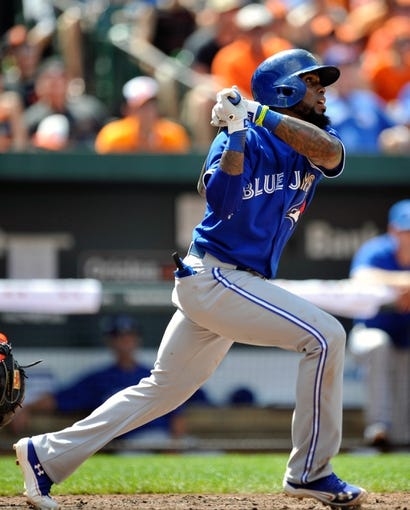 Jul 14, 2013; Baltimore, MD, USA; Toronto Blue Jays shortstop Jose Reyes (7) singles in the eighth inning against the Baltimore Orioles at Oriole Park at Camden Yards. The Orioles defeated the Blue Jays 7-4. Mandatory Credit: Joy R. Absalon-USA TODAY Sports
