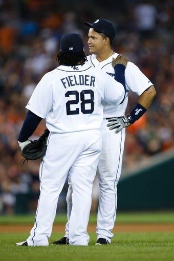 July 13, 2013; Detroit, MI, USA; Detroit Tigers designated hitter Prince Fielder (28) talks to third baseman Miguel Cabrera (24) against the Texas Rangers at Comerica Park. Mandatory Credit: Rick Osentoski-USA TODAY Sports