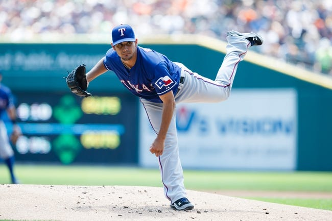 July 14, 2013; Detroit, MI, USA; Texas Rangers starting pitcher Martin Perez (33) pitches in the first inning against the Detroit Tigers at Comerica Park. Mandatory Credit: Rick Osentoski-USA TODAY Sports