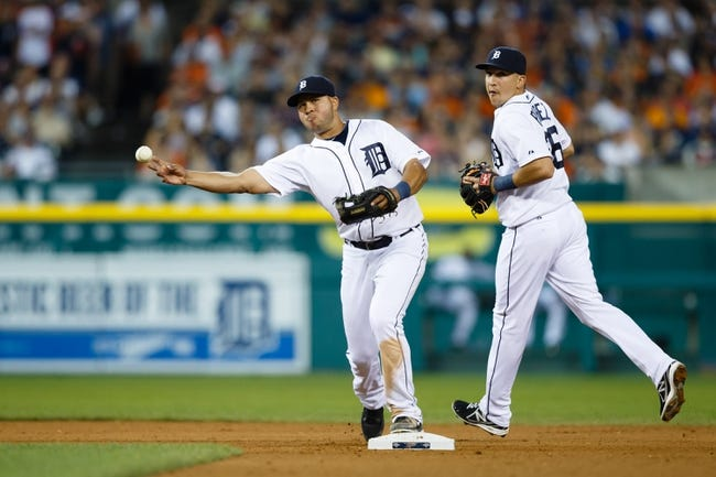 July 13, 2013; Detroit, MI, USA; Detroit Tigers shortstop Jhonny Peralta (27) makes a throw in front of shortstop Hernan Perez (26) against the Texas Rangers at Comerica Park. Mandatory Credit: Rick Osentoski-USA TODAY Sports