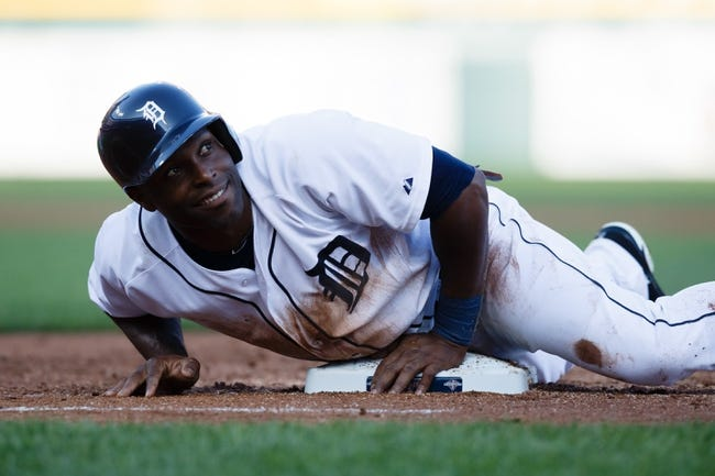 July 12, 2013; Detroit, MI, USA; Detroit Tigers right fielder Torii Hunter (48) dives back to first safe against the Texas Rangers  in the second inning at Comerica Park. Mandatory Credit: Rick Osentoski-USA TODAY Sports
