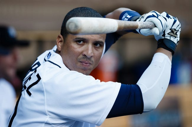 July 12, 2013; Detroit, MI, USA; Detroit Tigers designated hitter Victor Martinez (41) against the Texas Rangers in the dugout at Comerica Park. Mandatory Credit: Rick Osentoski-USA TODAY Sports