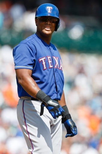 July 14, 2013; Detroit, MI, USA; Texas Rangers third baseman Adrian Beltre (29) walks to first after being hit by the pitch against the Detroit Tigers at Comerica Park. Mandatory Credit: Rick Osentoski-USA TODAY Sports