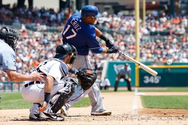July 14, 2013; Detroit, MI, USA; Texas Rangers right fielder Nelson Cruz (17) at bat in front of Detroit Tigers catcher Alex Avila (13) at Comerica Park. Mandatory Credit: Rick Osentoski-USA TODAY Sports