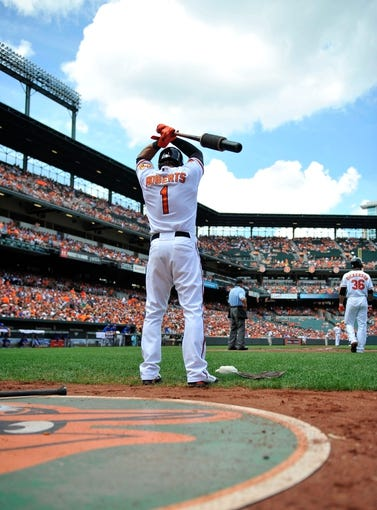 Jul 14, 2013; Baltimore, MD, USA; Baltimore Orioles second baseman Brian Roberts (1) in the on-deck circle during the first inning against the Toronto Blue Jays at Oriole Park at Camden Yards. The Orioles defeated the Blue Jays 7-4. Mandatory Credit: Joy R. Absalon-USA TODAY Sports