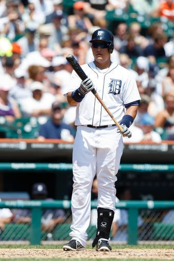 July 14, 2013; Detroit, MI, USA; Detroit Tigers third baseman Miguel Cabrera (24) at bat against the Texas Rangers at Comerica Park. Mandatory Credit: Rick Osentoski-USA TODAY Sports