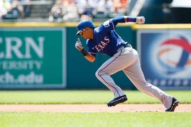 July 14, 2013; Detroit, MI, USA; Texas Rangers center fielder Leonys Martin (2) runs towards second against the Detroit Tigers at Comerica Park. Mandatory Credit: Rick Osentoski-USA TODAY Sports