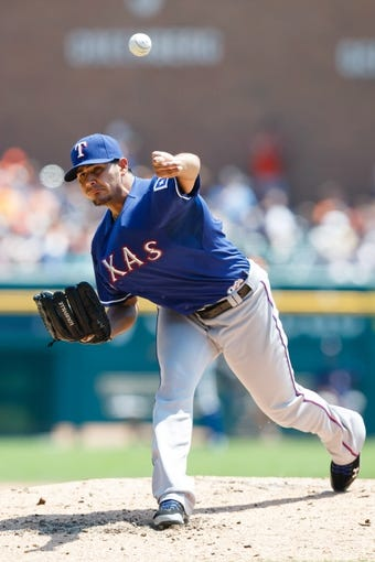 July 14, 2013; Detroit, MI, USA; Texas Rangers starting pitcher Martin Perez (33) pitches in the second inning against the Detroit Tigers at Comerica Park. Mandatory Credit: Rick Osentoski-USA TODAY Sports