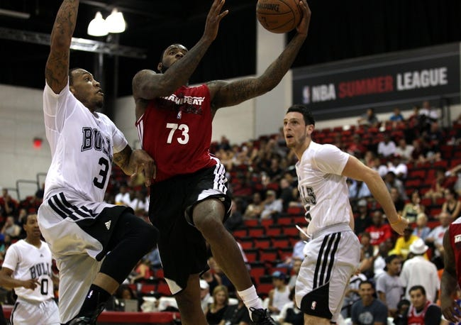Jul 18, 2013; Las Vegas, NV, USA; Miami Heat forward Damion James leaps to score between Bulls forward Malcolm Thomas, left, and guard Andy Rautins near the end of the first half of an NBA Summer League game at Cox Pavillion. Mandatory Credit: Stephen R. Sylvanie-USA TODAY Sports