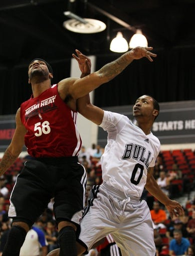 Jul 18, 2013; Las Vegas, NV, USA; Miami Heat guard D.J. Kennedy battles with Chicago Bulls guard Andrew Gouldelock for position underneath the basket during an NBA Summer League game at Cox Pavillion. Mandatory Credit: Stephen R. Sylvanie-USA TODAY Sports