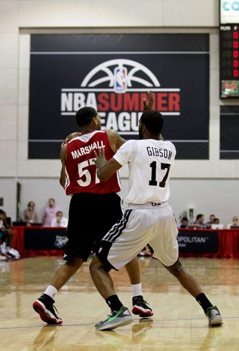 Jul 18, 2013; Las Vegas, NV, USA; Miami Heat guard Anthony Marshall, left, is closely defended by Chicago Bulls guard Kyle Gibson during an NBA Summer League game at Cox Pavillion. The Heat won the game 68-62. Mandatory Credit: Stephen R. Sylvanie-USA TODAY Sports