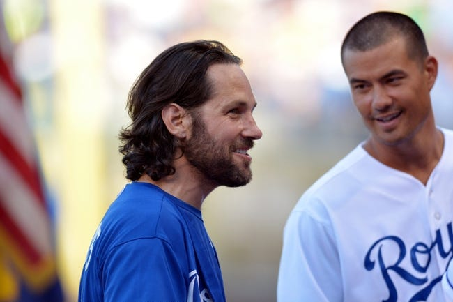 Jul 19, 2013; Kansas City, MO, USA; Paul Rudd laughs with Kansas City Royals starting pitcher Jeremy Guthrie (11) before the game against the Detroit Tigers at Kauffman Stadium. Mandatory Credit: Denny Medley-USA TODAY Sports