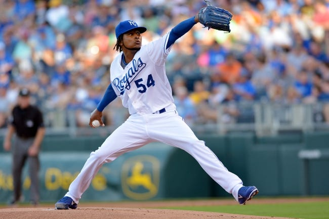 Jul 19, 2013; Kansas City, MO, USA; Kansas City Royals starting pitcher Ervin Santana (54) delivers a pitch in the first inning of the game against the Detroit Tigers at Kauffman Stadium. Mandatory Credit: Denny Medley-USA TODAY Sports