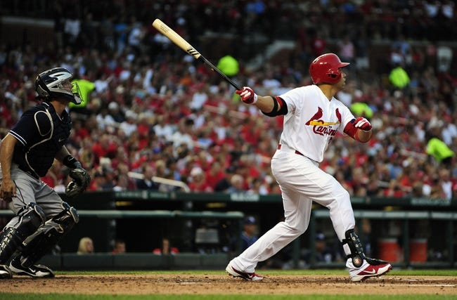 Jul 19, 2013; St. Louis, MO, USA; St. Louis Cardinals right fielder Carlos Beltran (3) hits a sacrifice fly off of San Diego Padres starting pitcher Jason Marquis (not pictured) during the third inning at Busch Stadium. Mandatory Credit: Jeff Curry-USA TODAY Sports